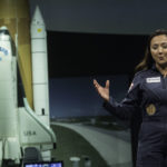 Shaesta Waiz speaks to a middle school girls at the Smithsonian National Air & Space Museum.